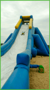 The cost of a day pass to the water slide is very affordable. Here's a kid enjoying a trip down the slide.